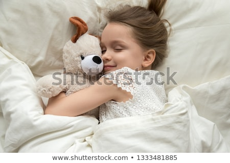 Kid on sleeping bed, happy bedtime in white bedroom Stock photo © zurijeta