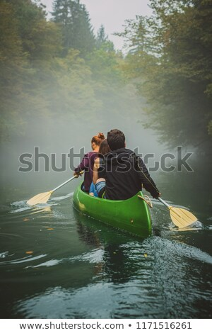 Blue canoe on the river in the mist Stock photo © CaptureLight