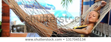 Smiling young woman enjoying a tropical vacation Stock photo © dash