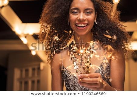 Jolie femme célébrer Noël feux d'artifice joli jeune femme Photo stock © dash