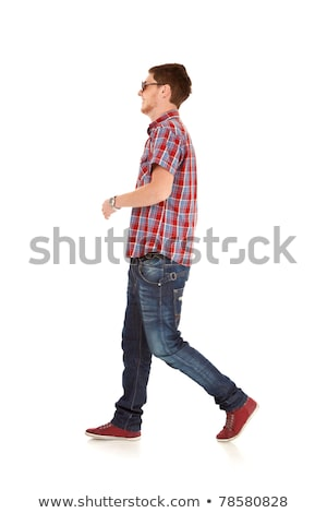 Vista lateral casual homem caminhada para a frente branco Foto stock © feedough