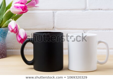 Black coffee mug mockup with  pink tulip  Stock photo © TasiPas