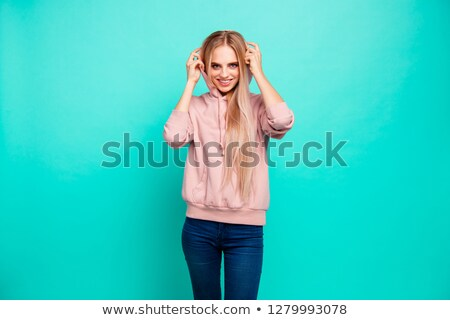 young skinny smiling woman wearing sporty clothes stock photo © feedough