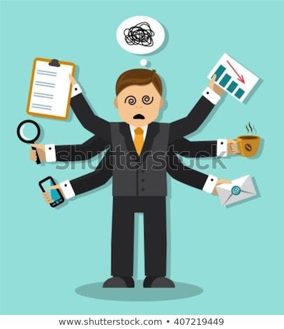 stressed businessman having lots of work to do stock photo © rastudio