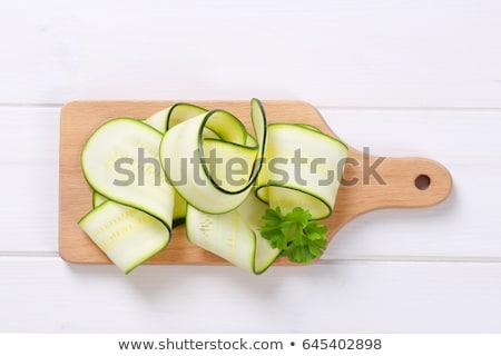 Nyers cukkini csíkok tányér fehér hely Stock fotó © Digifoodstock