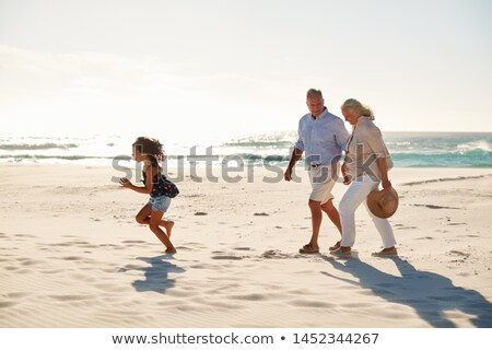 Senior couple walking with child Stock photo © IS2