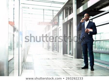 man talking on phone on walkway Stock photo © IS2
