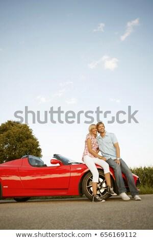 Pár ül elektromos sportautó autó szeretet Stock fotó © IS2