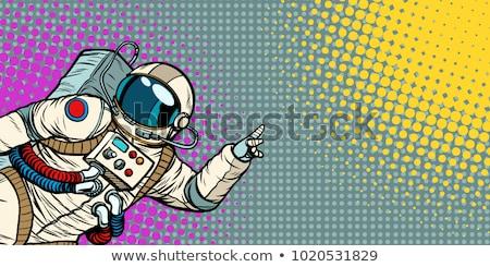 pop art astronaut points up Stock photo © studiostoks