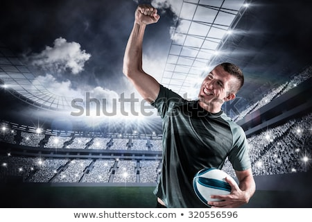 Composite image of rugby player cheering with the ball Stock photo © wavebreak_media
