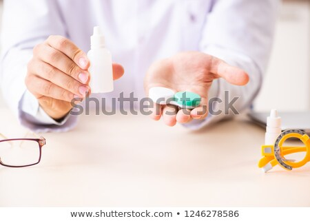 Young handsome doctor ophthalmologist with contact lenses in hos Stock photo © Elnur