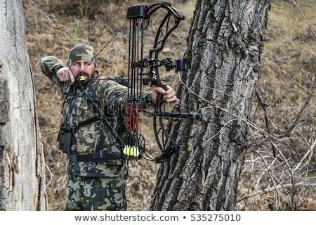 Stock photo: hunter aiming and ready for shot