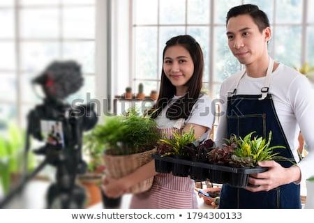 smiling couple making selfie by digital camera Stock photo © dolgachov