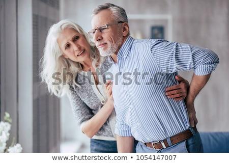 mujer · bajar · dolor · de · espalda · sesión · escritorio · portátil - foto stock © andreypopov