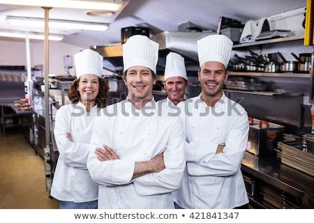 Alegre chef cozinhar uniforme em pé Foto stock © deandrobot