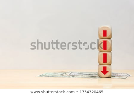 Red Decreasing Arrow Sign Over Banknotes Stock photo © AndreyPopov