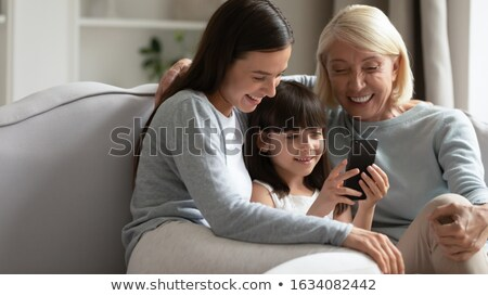 Playing mobile game with daughter Stock photo © pressmaster