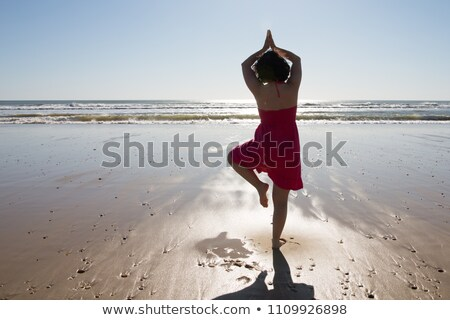 wioman exercising on beach stock photo © lovleah