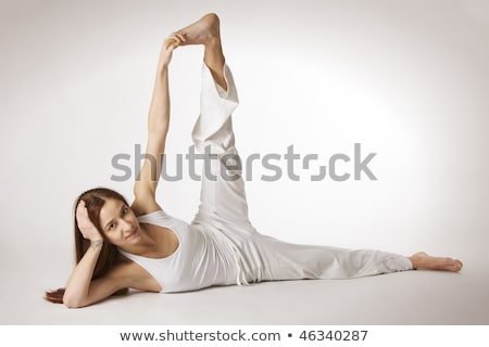 Woman side flank stretch Yoga posture (Parsvottanasana) Stock photo © lichtmeister
