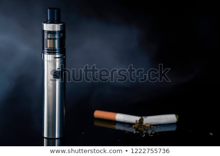 smoking electric cigarettes on the black background Stock photo © Lopolo