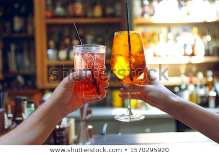 Woman and man raising a glasses of coktails Stock photo © dashapetrenko