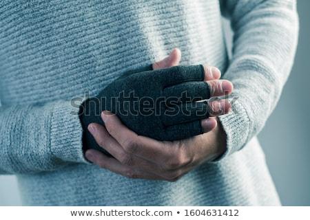 Férfi visel tömörítés kesztyű közelkép kaukázusi Stock fotó © nito
