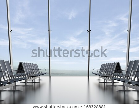 Empty chairs at waiting area in the airport terminal. Stock photo © artjazz