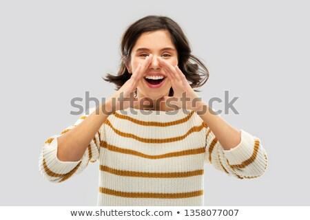 счастливым женщину полосатый свитер призыв кто-то Сток-фото © dolgachov