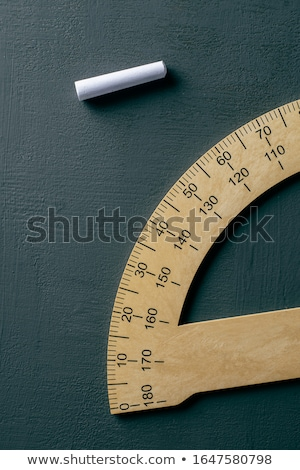 protractor and piece of chalk on a chalkboard Stock photo © nito