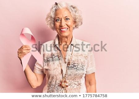 Staruszka różowy rak piersi świadomość wstążka zdrowia Zdjęcia stock © dolgachov