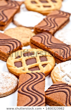 Cake bars filled with cream and tarts with dark chocolate isolat Stock photo © marylooo