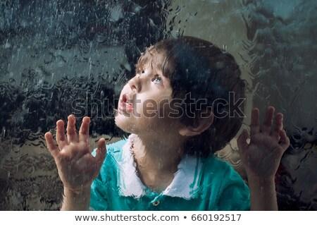 Regenachtig jongen uit venster dag Stockfoto © lovleah