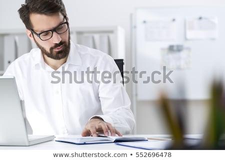 Portret młody człowiek za pomocą laptopa komórka Zdjęcia stock © HASLOO