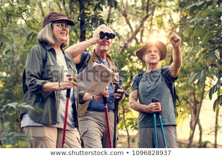 Senior man bird watching with binoculars stock photo © photography33