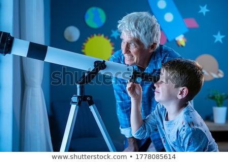 старший человека глядя телескопом синий человек Сток-фото © photography33