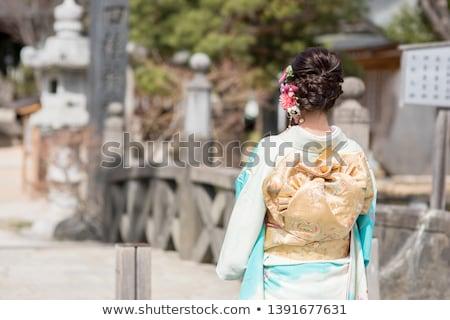 Lány áll izolált fehér mosoly arc Stock fotó © gorgev