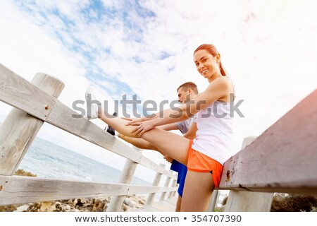 Couple doing exercises on the beach sand stock photo © get4net