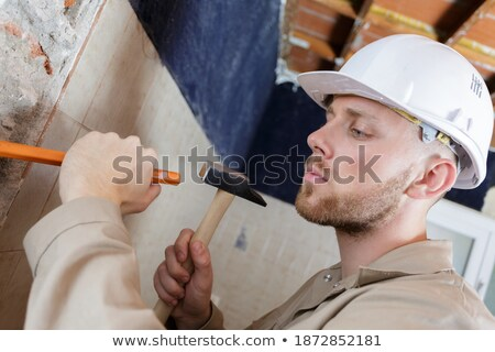 Builder hitting a wall with a sledgehammer Stock photo © photography33
