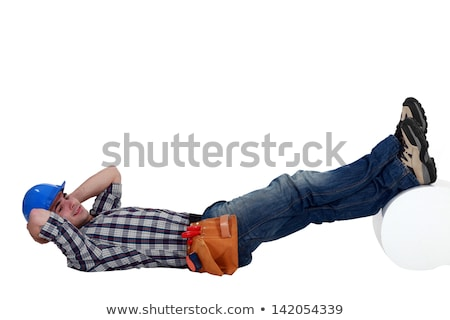 Construction worker lying down with his feet up Stock photo © photography33