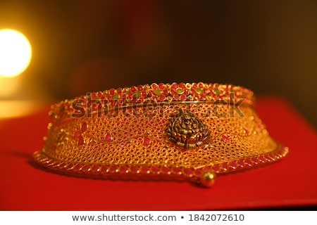 of a red background with pearls, gold ornaments Stock photo © yurkina