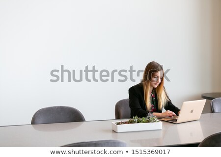 Attractive woman typing on a white wall Stock photo © nenetus