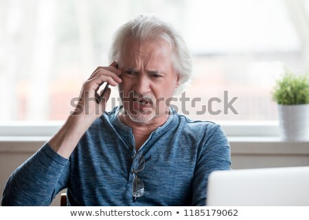 angry middle aged man yelling stock photo © stockyimages