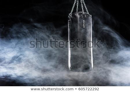 Fekete homokzsák box rúgás sport izolált Stock fotó © ozaiachin