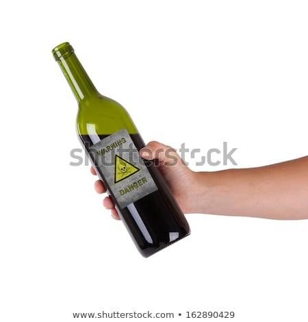 Mãos garrafa veneno isolado branco Foto stock © Klinker