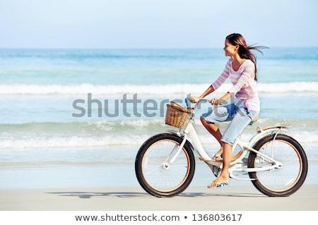 feliz · mulher · ciclismo · bicicleta · outono · parque - foto stock © vlad_star