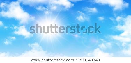 Zon blauwe hemel witte wolken natuur achtergrond Stockfoto © alinamd