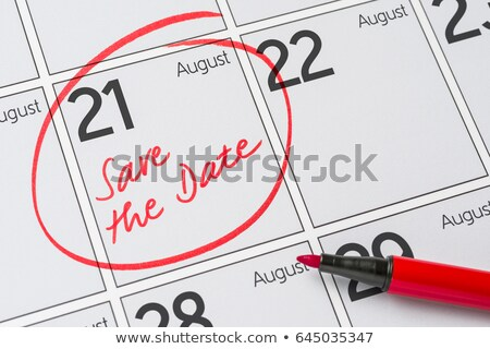save the date written on a calendar   august 21 stock photo © zerbor