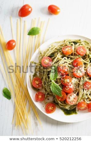 Spagetti domates pesto parma'ya ait plaka pişmiş Stok fotoğraf © Digifoodstock