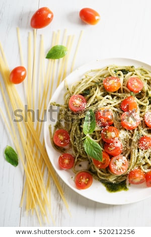 Espaguete tomates pesto parmesão prato cozinhado Foto stock © Digifoodstock