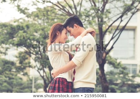 affectionate couple embracing each other in park stock photo © wavebreak_media